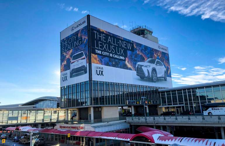 Edmonton International Airport - Lexus Canada - Pattison Outdoor Mesh Building Hoarding