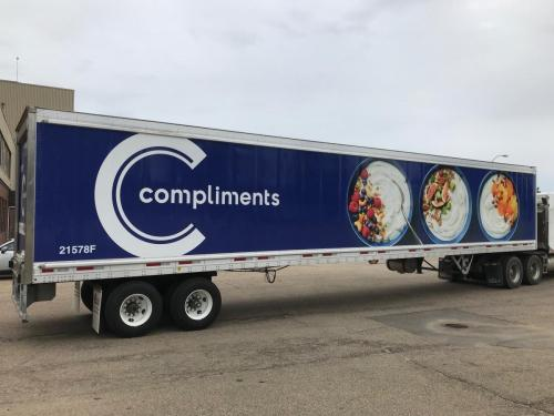Our Compliments Blue - Trailer Graphics - 06-25-20