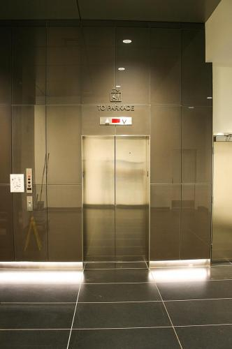 Stantec Tower Edmonton - Fabricated Stainless Steel Elevator Identification
